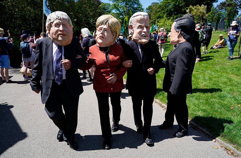 FOTO: Aktivisti za zaštitu životne sredine protestuju tokom samita G7