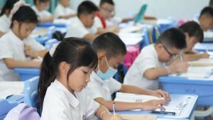 Kina, škola i deca: Vlasti žele da oslobode školarce domaćih zadataka